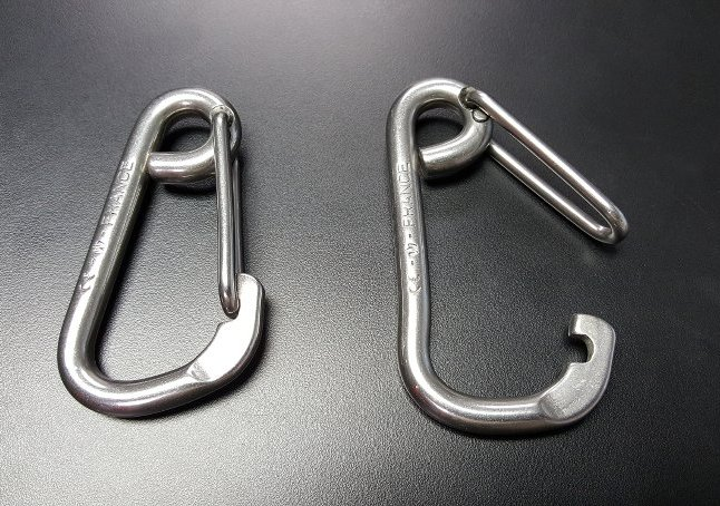 good and broken carabiner after testing at lifesaving systems
